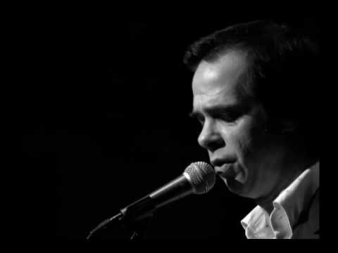 Nick Cave in Leonard Cohen's song Suzanne Suzanne takes you down to her place newer the river You can hear the boats go by You can spend the night besid...