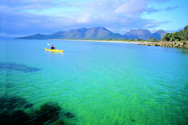 The Southern coast of Tasmania...  http://www.cntraveller.com/recommended/beaches/the-10-best-beach-holidays/adventure-beach#