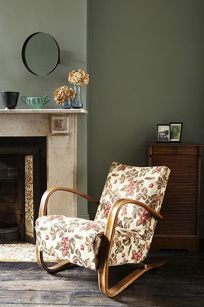 Credit: Rachel Whiting Art deco chair mirrors the fireplace tiling. The walls are Farrow & Ball's