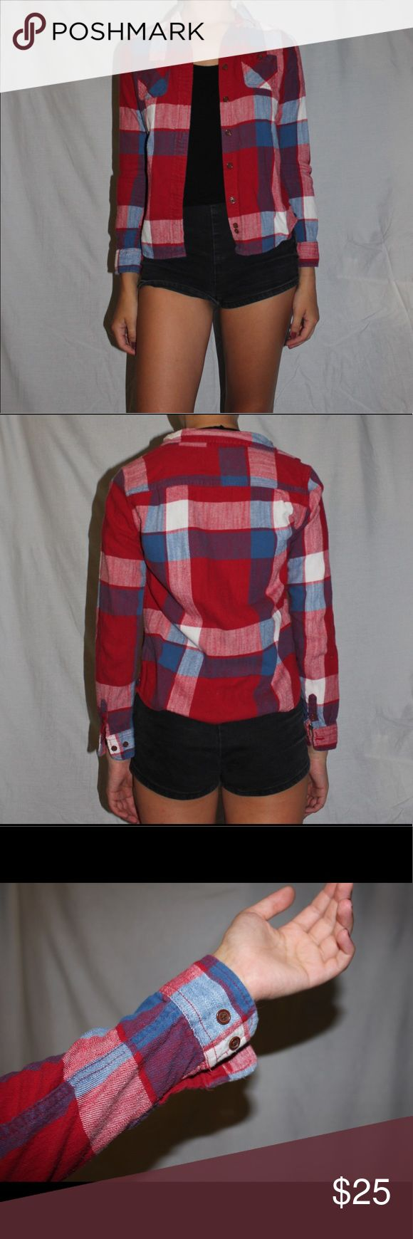 Red White & Blue American Eagle Flannel Red, white, and blue flannel from American Eagle Outfitters. All buttons intact, extra button on tag. 100% cotton, Size 4. Model Measurements: Height: 5'7; Weight: 135 pounds; Bust: 34 inches; Waist: 27 inches; Hips: 32 inches American Eagle Outfitters Tops Button Down Shirts