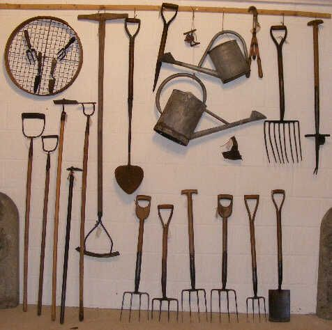 greenhouses and garden gates . . . old garden tools.