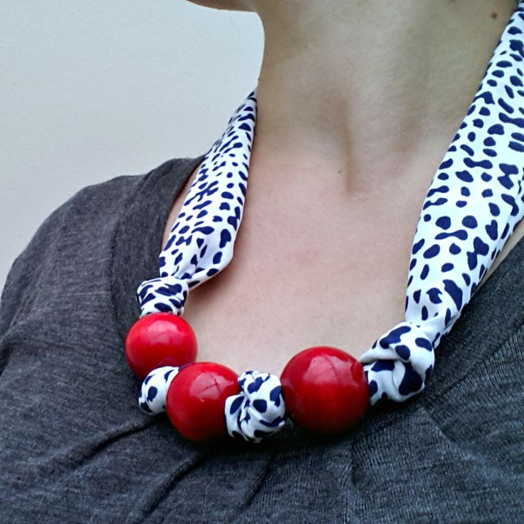 Handmade with recycled chunky wooden beads and vintage scarf. Closes with two glass buttons. https://cherryberry.felt.co.nz