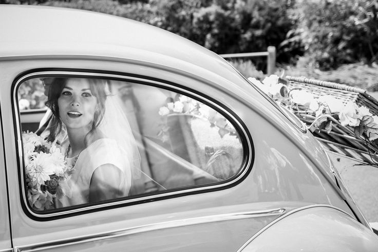 Deb & Michael's vintage style wedding at Sopley Mill in Hampshire, UK, by Angela Ward Brown. Vintage 60's wedding gown with cape.