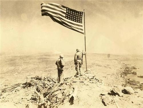 A rare look at the flag atop Mount Suribachi, Iwo Jima, after one of the bloodiest battles of World War II.