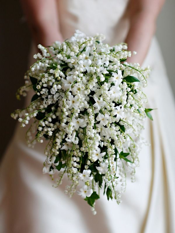 The most beautiful bridal bouquet I've ever seen--masses of lily-of-the-valley mixed with stephanotis. Both fragrance and pricetag must be astounding.
