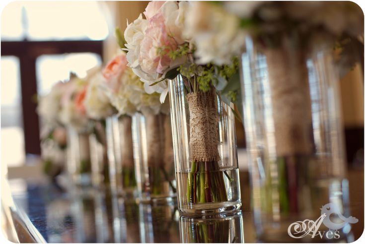 Place empty vases on the head table for bridesmaids to put their bouquets during the reception. Not only does it let them display their flowers, it also gives the bouquets a second role as centerpieces. Saves money on flowers.