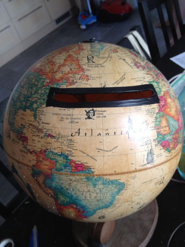 A card globe! I don't like the black duct tape lol but this is a cute idea for us since we want to travel! ;)