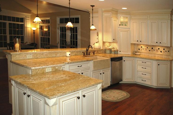 Bright Kitchen With Multilevel Peninsula Luxury Kitchens