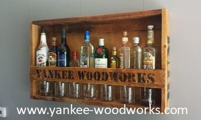 Liquor Rack -  This personalized rustic liquor rack is great for any bar or man cave. It is made from rough cut lumber, sanded, stained, and sealed to give it that reclaimed look. It is comes with whiskey written on one side and rum on the other. The front is up to you, just let us know what you want the front to say when placing your ordering the liquor rack. No the glasses nor liquor are included.