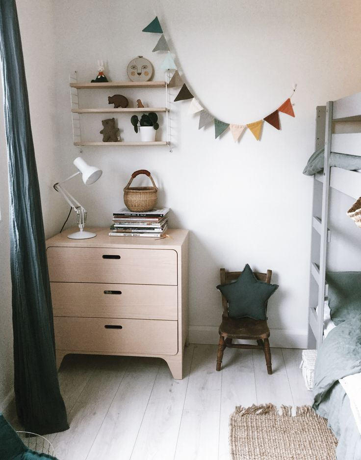 A muted, calm white kids room with natural wood accents.  https://velveteenbabies.com/2017/09/25/boys-room-tour/ #kidsroom #mutedcolours #kidsroom #kidsroomdecor #velveteenbabies #kidsinterior
