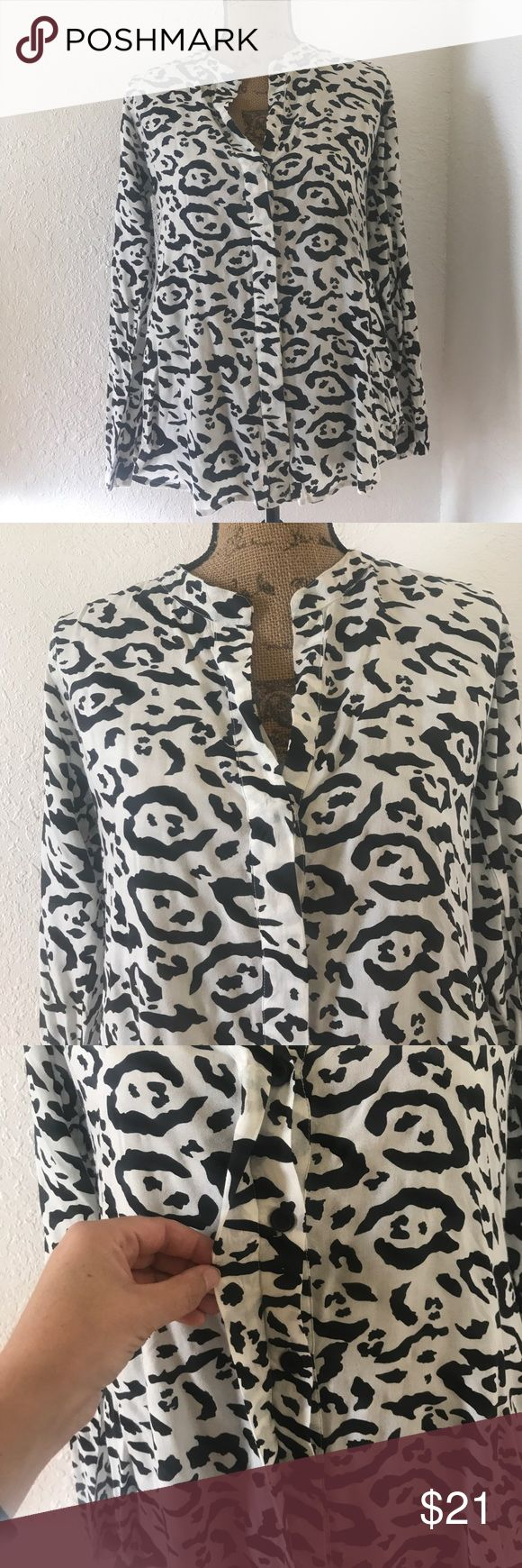 """Billabong Leopard Print Button Up Blouse FIRM PRICE + 4th & Bleeker for Billabong brand, black & white leopard print, button up Blouse. 100% Rayon - feels & looks like linen. Size M - 20"""" armpit to armpit, 23"""" shoulder to bottom hem, 24"""" sleeve length. In EUC - worn 2x's, no rips, stains or holes.  Style with black or blue jeans, shorts or skirts. Accessorize with hot pink, red or silver. Non smoking home. No trades. Billabong Tops Blouses"""
