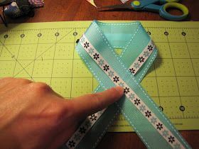 These are easy no sew cheer bows that any little girl will love!     You will need ribbon......I like to use 1.5 inch gross grain ribbon...