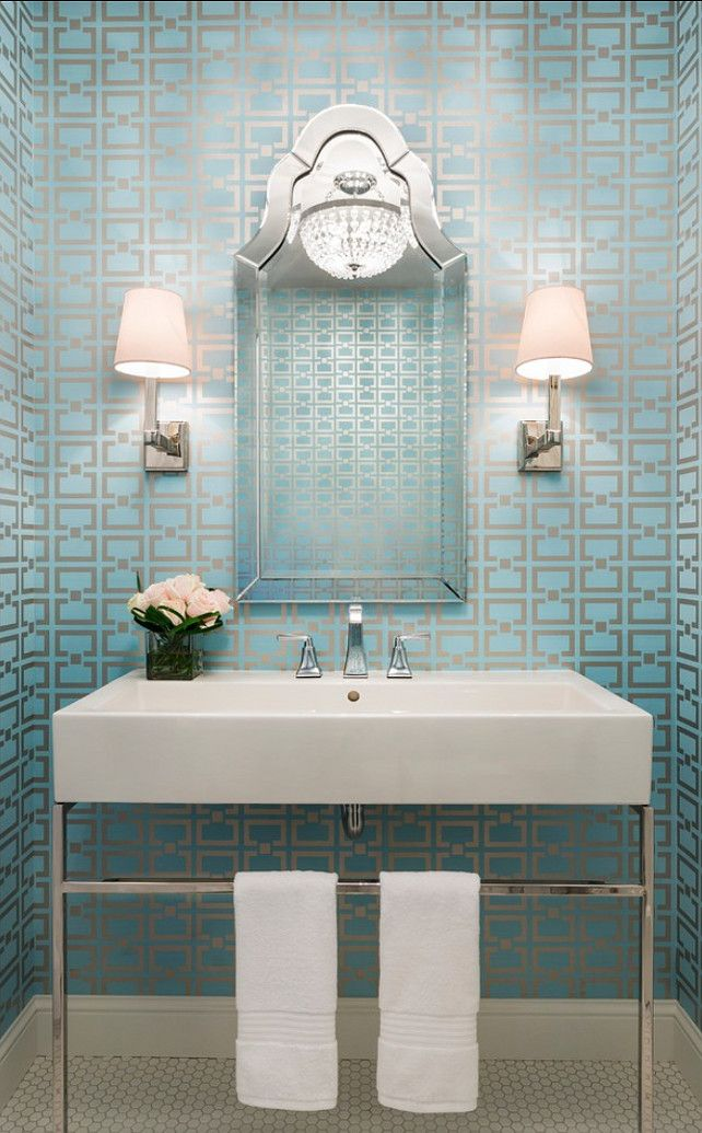 I love the combination of the clean geometric lines of the wallpaper, vanity and sconces with the more ornate mirror and chandelier. {design :: martha o'hara}