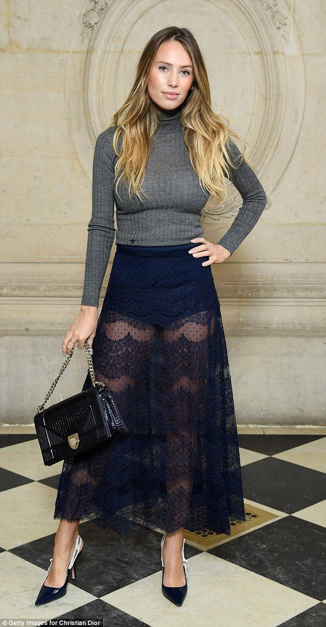 Stunner: Dylan Penn turned heads as she showed off her endless pins in a navy lacy skirt at the Christian Dior show for Paris Fashion Week on Tuesday