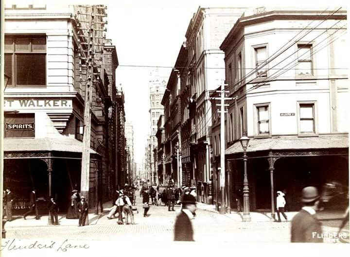 View of Flinders Lane, Melbourne,Victoria.Looking west from Swanston St. Horse and carriage and pedestrians in laneway in  1893.