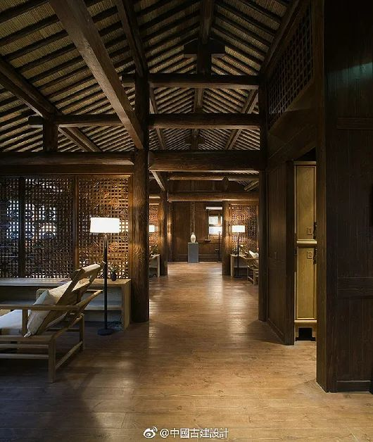 A traditional southern-style Chinese interior design with lattice partition w...