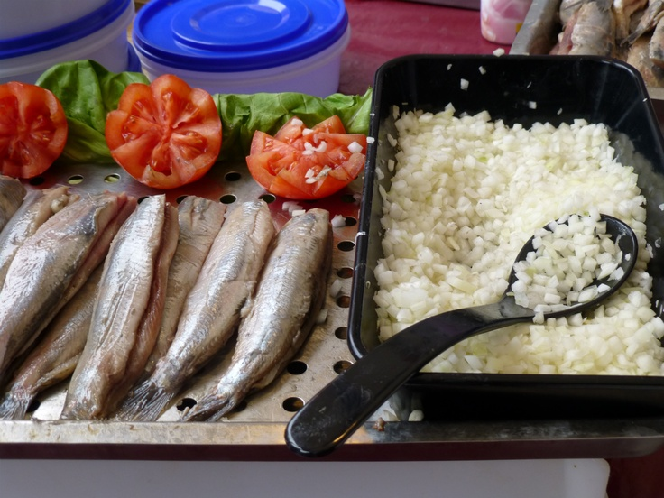 "Herring in Delft. A typical Dutch snack is the ""Hollandse Nieuwe"" (trans.: ""Holland New One""), or ""Zoute Haring"" (""soused herring""). It is raw herring from the North Sea catches end of spring."