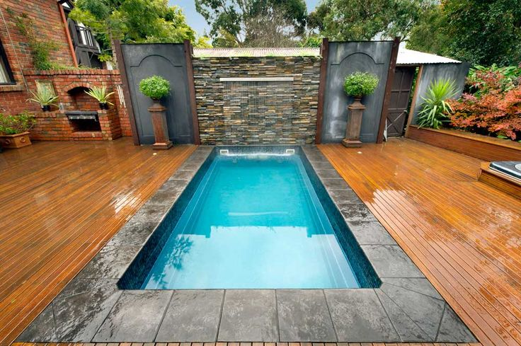 Wall Fountains contemporary backyard plunge