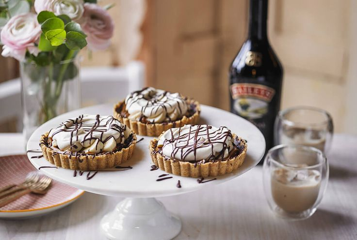 Mini Baileys banoffee pies drizzled with chocolate