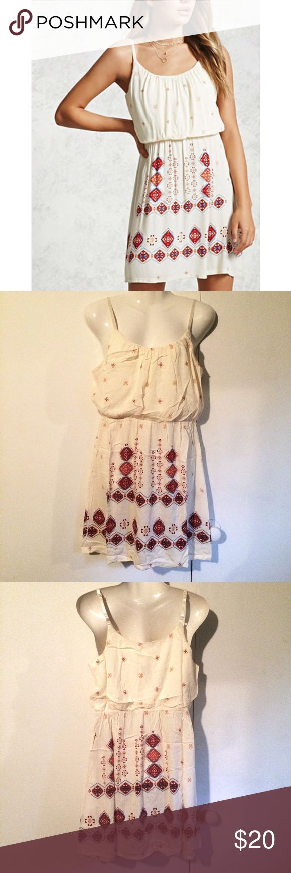 """NEW Ivory Cream Ornate Red Orange Strappy Dress New w/o tags! Ordered online, didn't have tags attached but does have its plastic manufacturer's bag! Ivory cream strappy cami dress with a vintage feel. Ornate red and orange print on skirt. Lined bust, but not a lined skirt. Elasticized waist, no zipper. Adjustable straps. App. 33"""" length shoulder to hem. Loose in the bust, so a bust measurement is a little hard to determine - just roomy. 100% rayon, polyester lining. The dress is F21's…"""