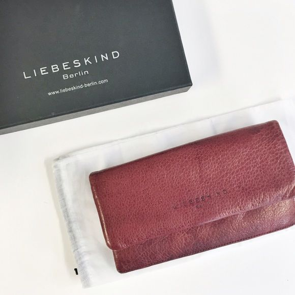 Liebeskind | red slam clutch/wallet Liebeskind Slam Clutch.   A slim Liebeskind clutch rendered in supple leather. Snap closure. Leather-lined interior with dividing zip pocket, 4 bill slots, and 10 card slots. Exterior zip pocket. Dust bag included.  Leather: Cowhide. Muted/Distressed Red leather. (used but in good condition).  Measurements Height: 4.5in / 11.5cm Length: 7.5in / 19cm   NO TRADES Liebeskind Bags Wallets