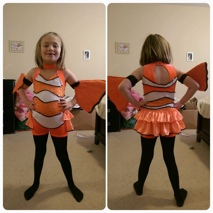 Nemo costume! Took an orange tap outfit found on eBay and embellished with white felt, black sequins and hot glue! Fins make from sequin bands, foam sheets and felt sheets with black sequin trimming.