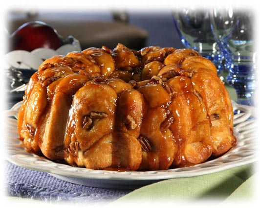 Caramel Bubble Rolls!  Frozen dinner rolls dipped in butterscotch pudding powder drizzled with pecans, brown sugar and butter in bundt pan.  Prep the night before.  Next morning pop in oven @350 for 30 mins.  I am making these this week!
