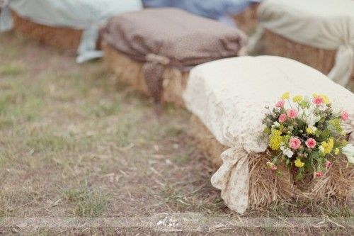 square hay bales with fabric over them make adorable seating for a farm or barn wedding!
