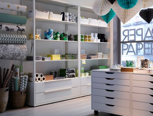 a paper shop with white shelving units and drawer units on. Black Bedroom Furniture Sets. Home Design Ideas