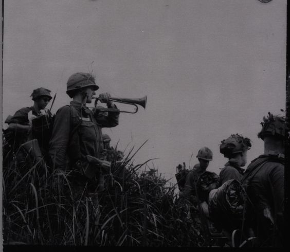 US Army PFC Ira Rolston sounding a captured Viet Cong bugle in the Ia Drang Valley Battle.