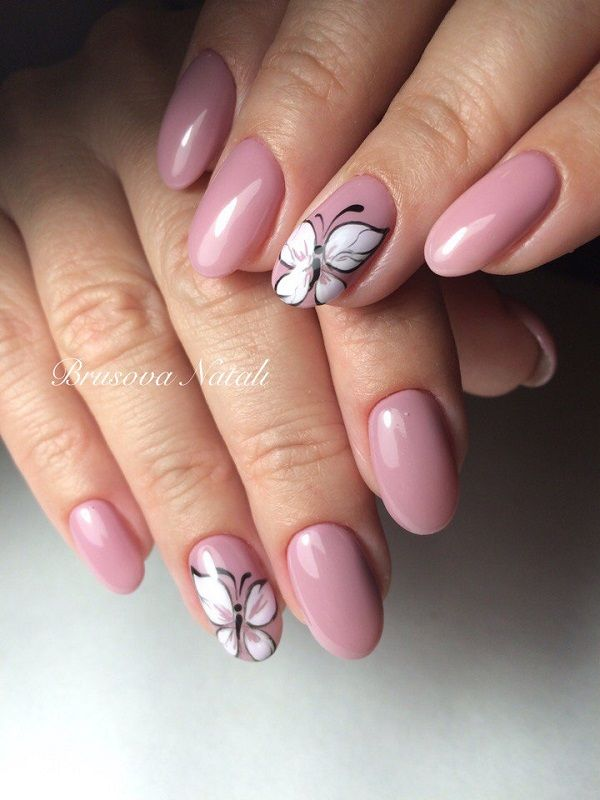 Pretty in pink winter nail art design. The nails are colored in carnation pink nail polish while the butterfly detail on top is painted in white and black nail polish.