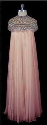Adolfo 1960's silk chiffon sleeveless trapeze gown with heavily beaded and jewelled capelet style bodice. Adolfo Ardina began making couture privately in 1965, the Duchess of Windsor, Betsy Bloomingdale, and Nancy Reagan were loyal clients throughout his 25 year career. LOOOOOOVE!