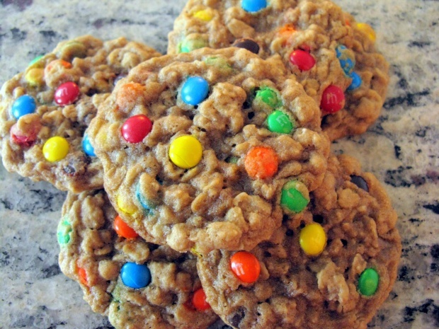 Chewy Oatmeal M Cookies    1/2 cup (1 stick) unsalted butter, softened to room temperature   3/4 cup dark brown sugar   1/2 cup sugar   1 egg   2 tsp vanilla   1/2 tsp baking soda   1/2 tsp cinnamon   1 and 2/3 cups old-fashioned rolled oats   1 cup all-purpose flour   3/4 cup mini M
