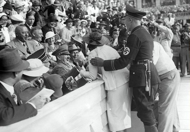"""historicaltimes: """" Hitler reacting to an American woman who kissed him at the Berlin Olympics Opening Ceremony, 1936. Weiterlesen."""