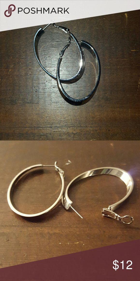 Lia Sophia Earrings Lia Sophia hoop earrings. They have a beautiful asymmetrical slant that you can see in picture 2. Lia Sophia Jewelry Earrings