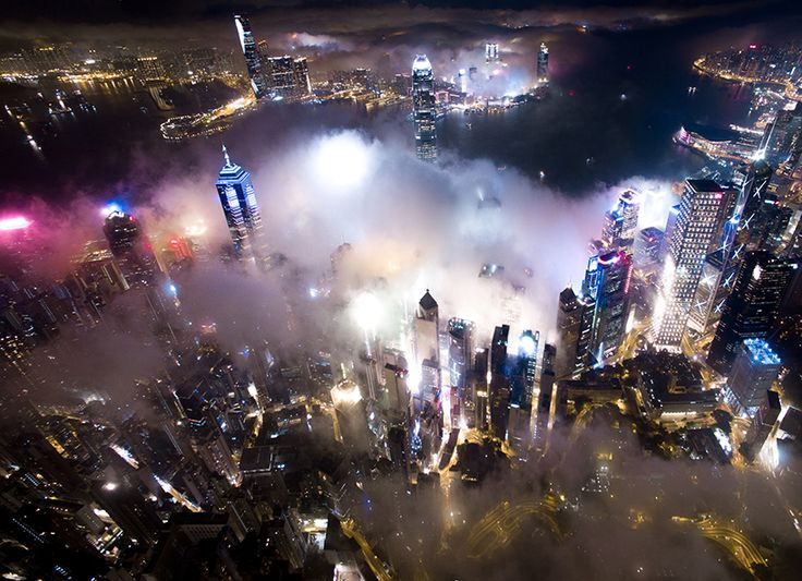 andy yeung's drone photos rise above hong kong at night to capture urban fog