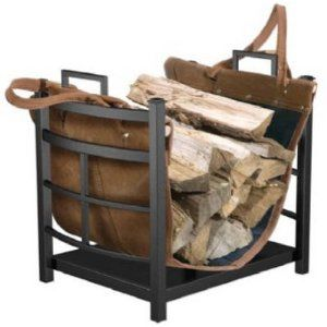 indoor firewood storage - I like that the leather strip can also be used to carry the wood.