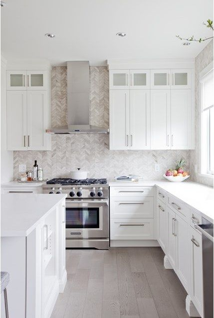 648d4ce8a588a4b3f91c1ef677d89642  jillian harris custom cabinets Custom Cabinets & harringbone pattern tile backsplash in this kitchen designed b...