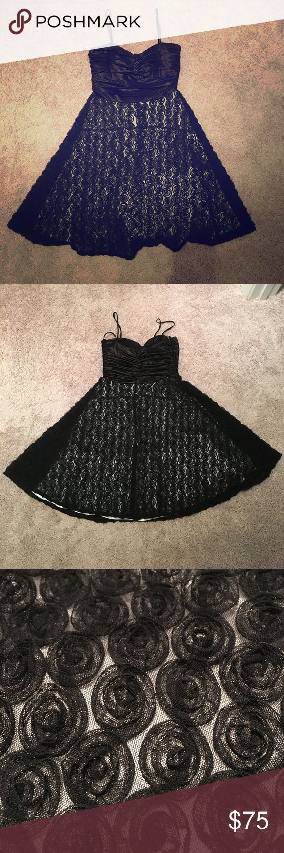 Black Cocktail Dress! Brand is Intrigue from Davids Bridal. The perfect special occasion little black dress with popular rose overlay. Small fit for a size 4.  I wore this once to a wedding. It has tulle underneath the skirt to make it poof out a little. Could be worn strapless if you just tuck the straps in. Length from where the strap connects, to the bottom of the skirt, is 27.5 inches. I shortened the straps but you could easily remove the thread to make them long again. See photo…