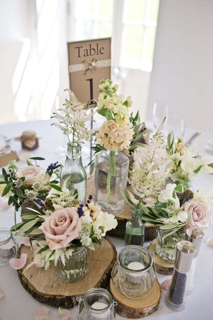 Soft, deconstructed and rustic table centrepieces ideal for a more informal yet elegant Scottish wedding