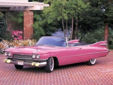 1959 Pink Cadillac Eldorado. 1959 was the Year of the Fins in all cars and this was the top of the line.