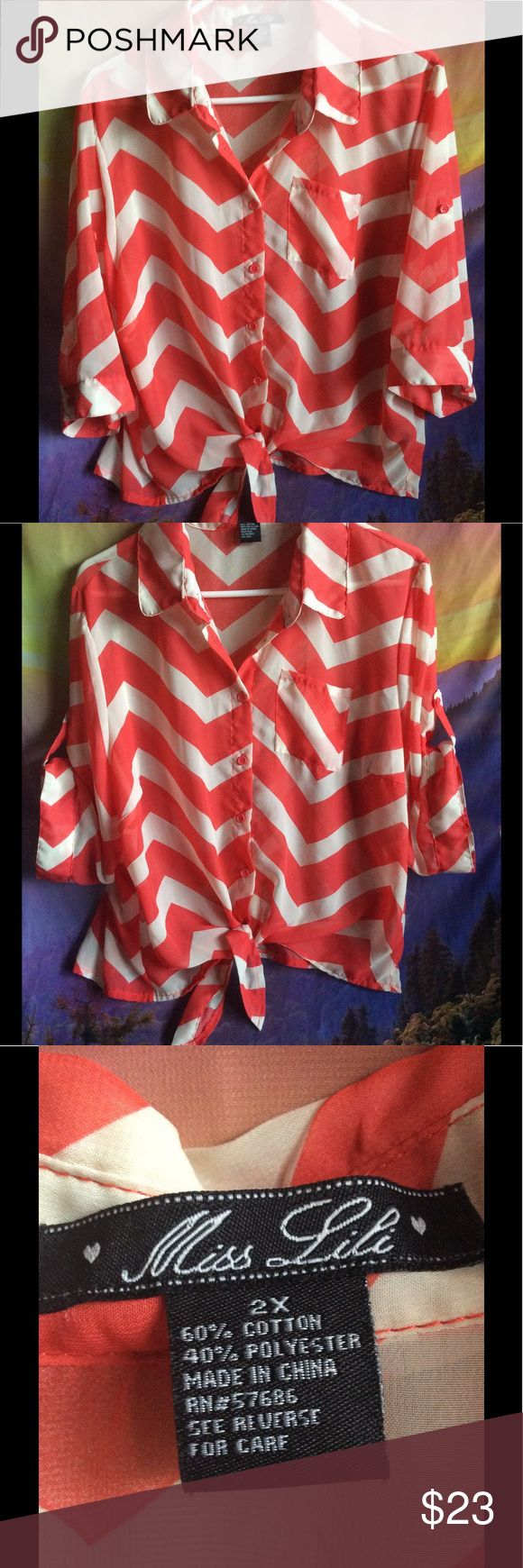 Super cute Plus Size chevron sheer shirt Spring fling shirt! So versatile! Where the sleeves folded up and buttoned or wear them . down for a dressier look. Ties in the front Chevron .Coral and cream color. Size 2X super pretty! Excellent preowned condition Miss Lili Tops Button Down Shirts