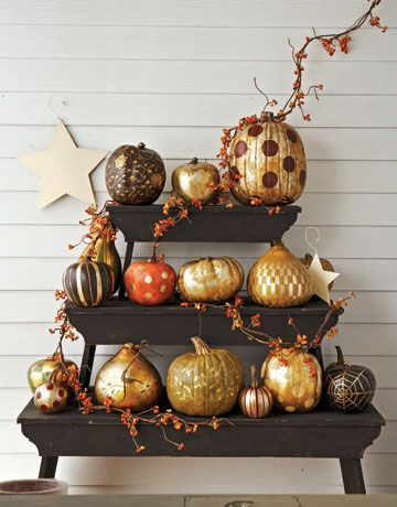 I love the use of gold in these painted pumpkins. This site