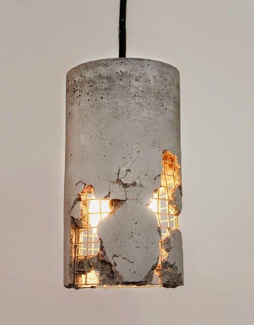Pendant light with broken concrete creates the illusion of a building falling apart. #lighting #lightingdesign