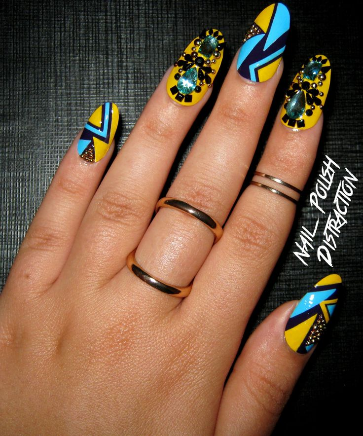 """New nails!! What I used: Yves Rocher """"Citron"""", Yves Rocher """"Bleu Nigelle"""" and Yves Rocher """"Iris"""". Black multi-shaped rhinestones, gold studs and blue gemstones are all from BornPrettyStore (use code..."""
