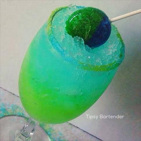 Razz Melon Sour Cocktail - For more delicious recipes and drinks, visit us here: www.tipsybartender.com
