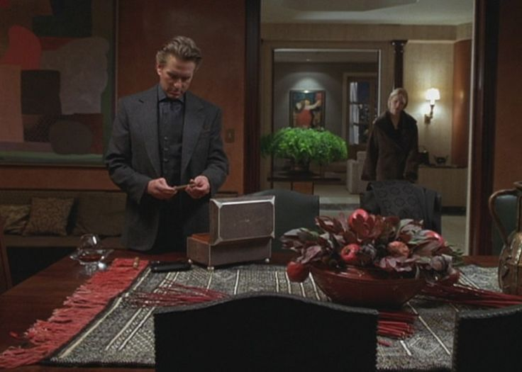 A Perfect Murder with Gwyneth Paltrow - Steven filling his leather cigar case for game night.