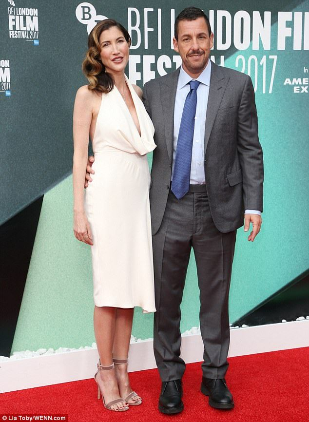Co-star: Also taking to the red carpet was Emma's co-star Adam Sandler and his wife Jackie