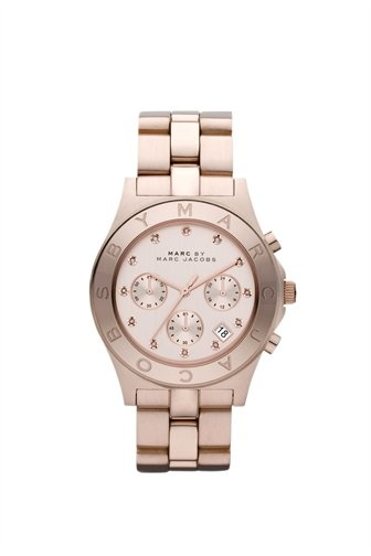 Marc by Marc Jacobs Blade watch featuring IP rose gold 40MM stainless steel case with etched logo on top ring. Stainless steel IP rose gold bracelet with brushed outerlinks and shiny center links. Rose gold dial with shadowed rose gold stones at each hour and chrono rings.