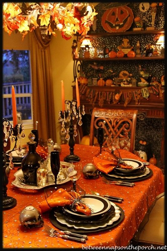halloween tablescape with potion centerpiece love the gold star netting over the orange table cloth - Halloween Table